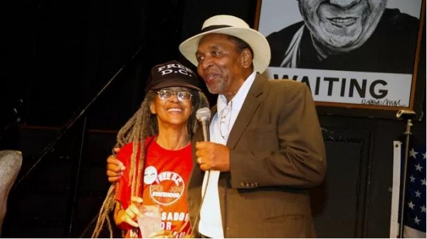 Anise Jenkins and Frank Smith share a moment during the Stand Up! for Democracy in DC Founders' Day event on Aug. 3.