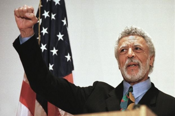 In this Nov. 17, 1997 file photo Democratic Rep. Ron Dellums raises his fist while announcing his retirement from Congress at a news conference in Oakland, Calif. Dellums, a fiery anti-war activist who championed social justice as Northern California's first black congressman, has died at age 82. Longtime adviser Dan Lindheim says Dellums died early Monday, July 30, 2018, at his home in Washington, DC, of cancer.