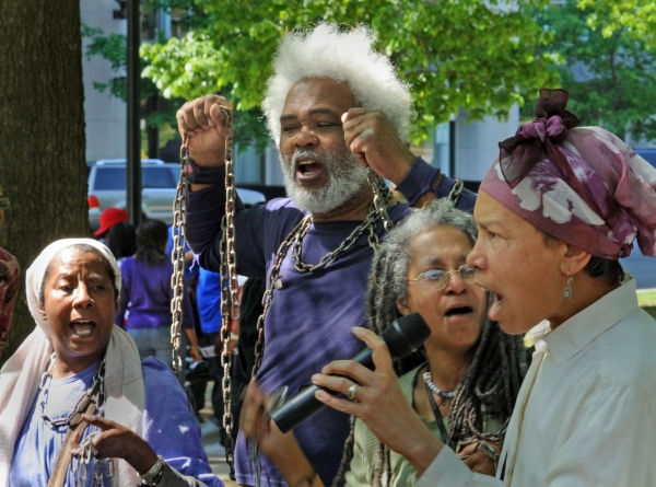 Ayo Handy Kendi, left, Tabu Henry Taylor, Anise Jenkins, and Luci Murphy sing at the D.C. Emancipation Day Rally and March in 2010.