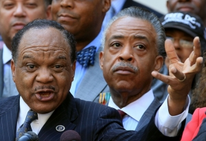 The Rev. Walter Fauntroy gestures as he speaks, while the Rev. Al Sharpton listens during a news conference in front of the John A. Wilson Building on August 27, 2010 in Washington, DC..The news conference was held to announce a march to commemorate the 47th anniversary of the Rev. Dr. Martin L. King, Jr.'s March on Washington. August 26, 2010