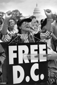 A 'Free DC' rally on the Capitol grounds and March to the Hart Office Building to protest congressional denial of civil rights to District citizens. Protestor Loree H. Murray, 76, applauds speakers.