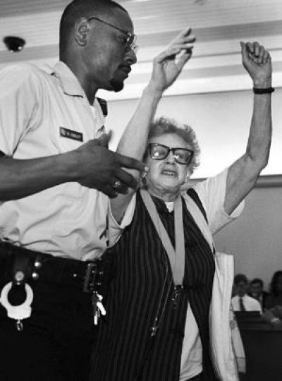 Winifred Gallant gets hauled out of the DC Council Chambers at One Judiciary Square after the convention center discussion vote.